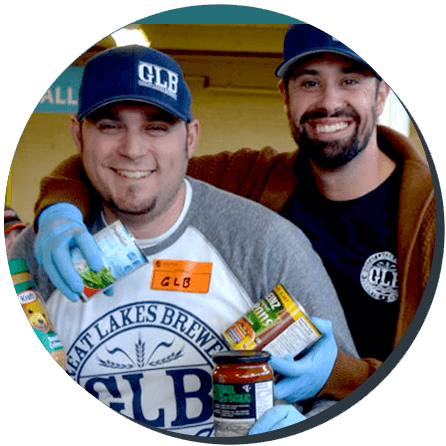 Two men from Great Lakes Brewery volunteer